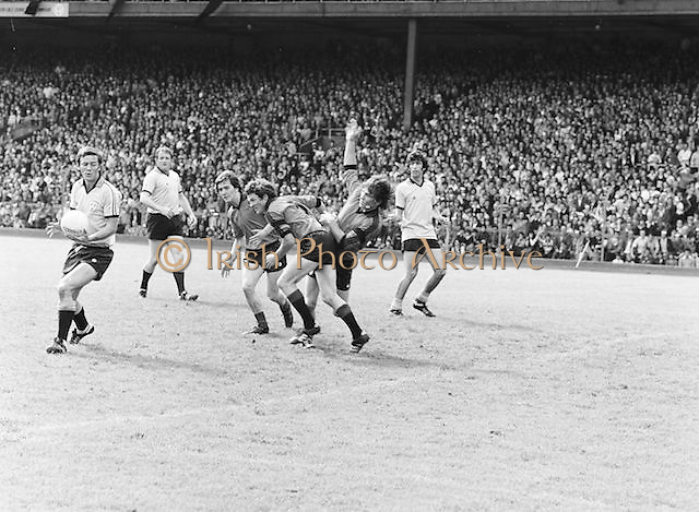 Dublin holds off a Kerry player to allow his team make to clear the ball during the Kerry v Dublin All Ireland Senior Gaelic Football Final in Croke Park on the 24th of September 1978. Kerry 5-11 Dublin 0-9.
