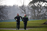 Wales head coach Warren Gatland ® and assistant coach Robert Howley walk to the training field.Wales rugby team announcement and training at the Vale Resort in Hensol, near Cardiff , South Wales on Tuesday 17th March 2015. The team are preparing for their next RBS Six nations match against Italy this weekend. <br /> pic by Andrew Orchard, Andrew Orchard sports photography.