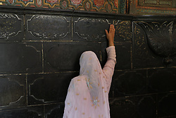 August 29, 2017 - India - Kashmiri Muslim woman pray inside the Shah-e-Hamdan shrine to commemorate the death anniversary of Sufi scholar Mir Syed Ali Hamadani in Srinagar, Indian controlled Kashmir, on Tuesday 29 August 2017 Hundreds of Kashmiris visited the shrine of Hamadani, who was born in Iran, visited Kashmir several times and played an influential role in the spread of Islam in the valley. (Credit Image: © Umer Asif/Pacific Press via ZUMA Wire)