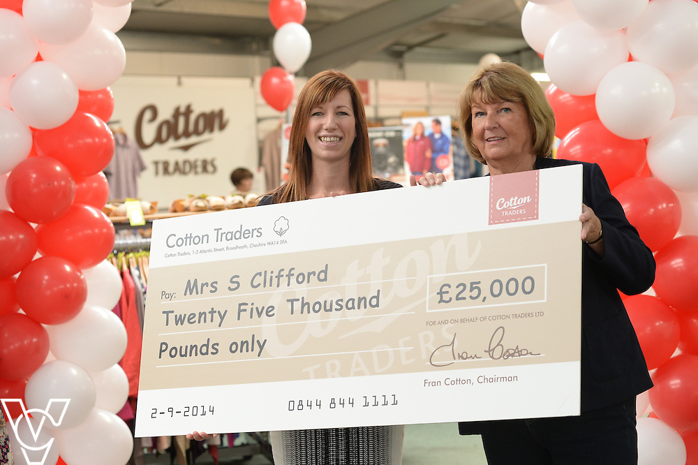 Sandra Clifford has won £25,000 in Cotton Trader's annual competition.<br /> <br /> Pictured, from left, Cotton Traders head of marketing and ecommerce Shona Jameson presents Sandra Clifford with her cheque for £25,000<br /> <br /> Picture: Chris Vaughan/Chris Vaughan Photography<br /> Date: September 2, 2014