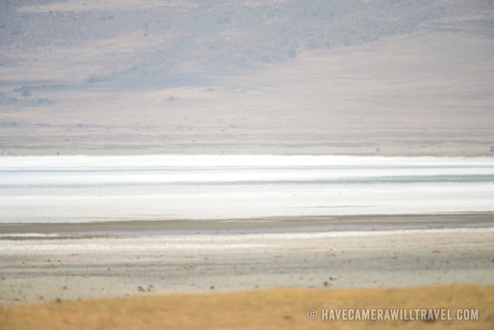 The salt lake (Magadi Lake) shimmers in the heat at Ngorongoro Crater in the Ngorongoro Conservation Area, part of Tanzania's northern circuit of national parks and nature preserves.