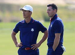 Team Europe's Rory McIlroy (right) and Thorbjorn Olesen on the fifteenth fairway during the Fourballs match on day one of the Ryder Cup at Le Golf National, Saint-Quentin-en-Yvelines, Paris.