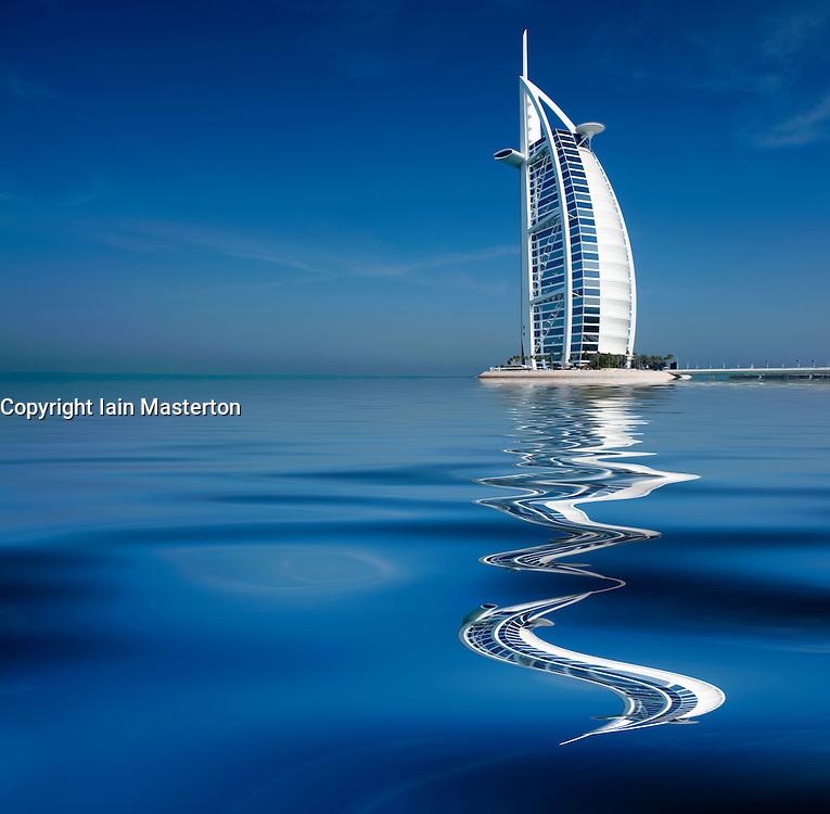 Burj al Arab luxury hotel seen reflected in water in Dubai United Arab Emirates