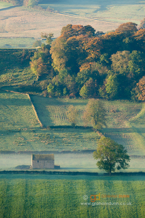 A stone barn and early autumn colours in the Upper Dove Valley. A colourful landscape scene on the Derbyshire-Staffordshire border, near to Longnor in the Peak District. England, UK.
