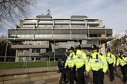 © Licensed to London News Pictures. 14/02/2020. London, UK. Police officers walk past the QEII Conference Centre in Westminster. A person attended the UK Bus Summit on 6 February has been confirmed positive with coronavirus. Photo credit: Dinendra Haria/LNP