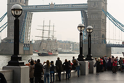 © Licensed to London News Pictures. 19/09/2014. London, UK. People watch the Sail Training Ship, Lord Nelson arrive in London on the River Thames under Tower Bridge on 19th September 2014. Photo credit : Vickie Flores/LNP