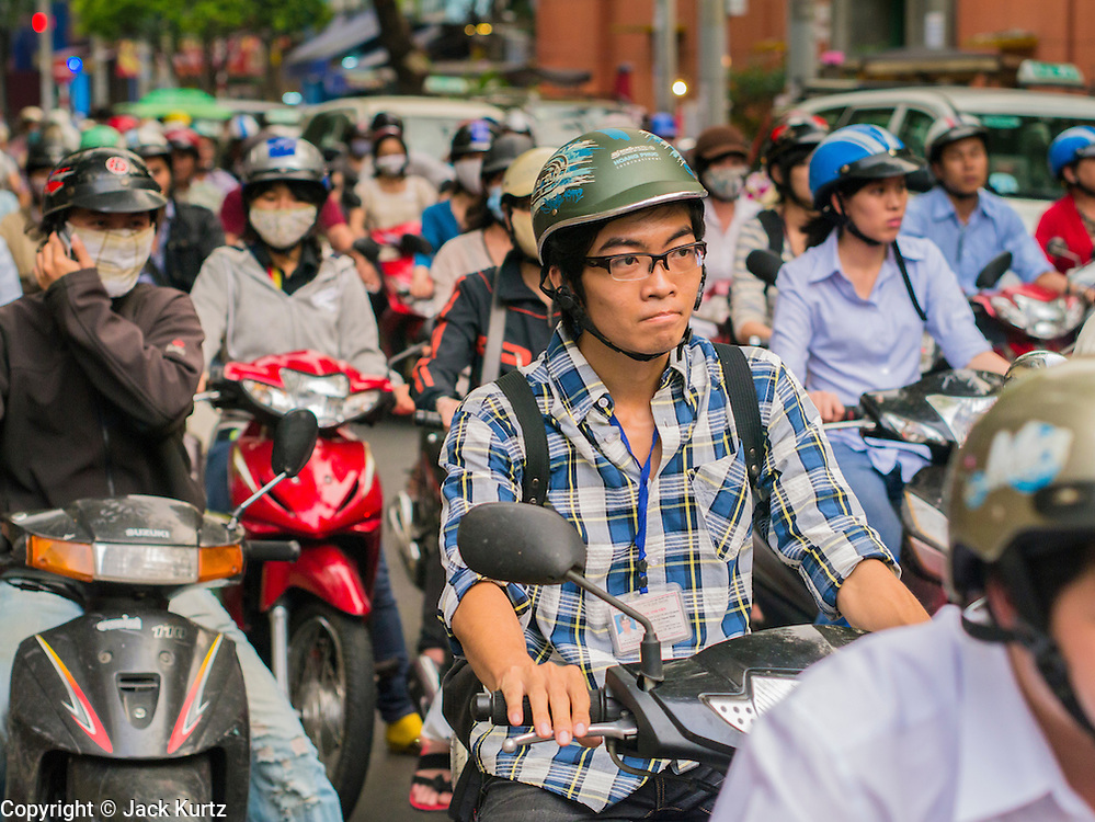 28 MARCH 2012 - HO CHI MINH CITY, VIETNAM:   Motorscooter traffic in Ho Chi Minh City, (Saigon) Vietnam. Motorscooters are the main form of private transportation for millions of Vietnamese.     PHOTO BY JACK KURTZ