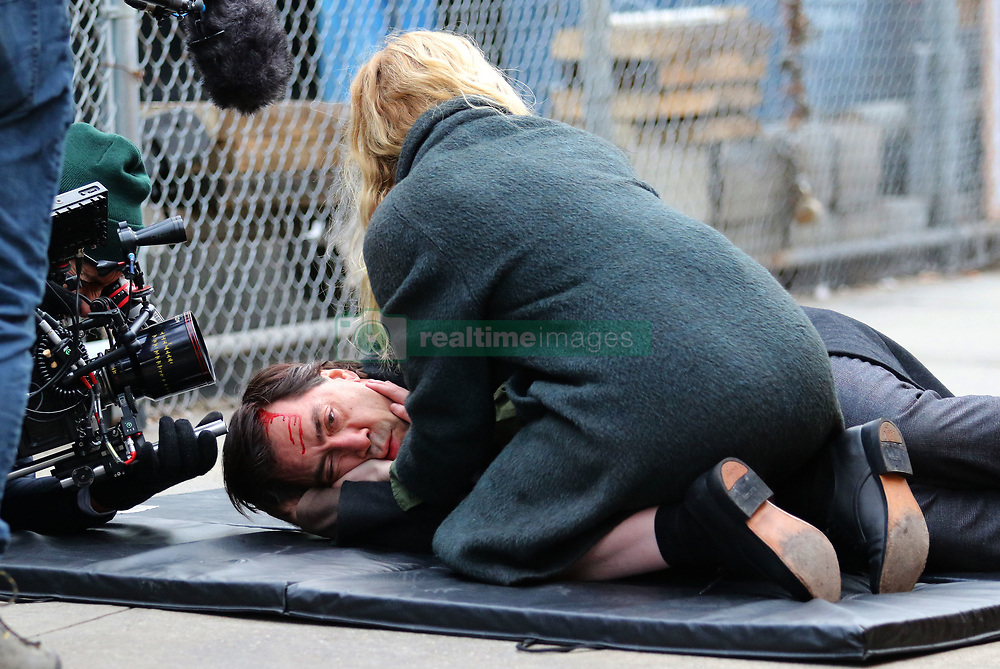 """Javier Bardem and Elle Fanning are seen filming an intense dramatic scene on the set of their upcoming movie """"Molly"""" in Brooklyn. The scene involved Javier getting tangled and struggling to get out of a cab where he falls face first to the ground and bleeds from the forehead as his costar Elle Fanning is seen holding him and crying out for help. Javier will be playing a mental person and will be the father of his costar Elle Fanning. 16 Jan 2019 Pictured: Javier Bardem and Elle Fanning. Photo credit: LRNYC / MEGA TheMegaAgency.com +1 888 505 6342"""