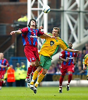 Photo. Chris Ratcliffe<br /> Crystal Palace v Norwich City. Barclays Premiership. 16/04/2005<br /> Darren Huckerby of Norwich goes up for this aerial ball with Danny Butterfield of Palace