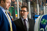 KELOWNA, BC - OCTOBER 23: Dean Brockman, head coach speaks to assistant coach Scott Dutertre on the bench of the Swift Current Broncos against the Kelowna Rockets at Prospera Place on October 23, 2018 in Kelowna, Canada. (Photo by Marissa Baecker/Getty Images) ***Local Caption***