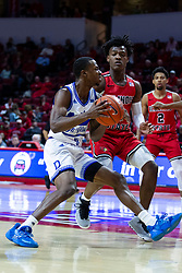 NORMAL, IL - February 22: D.J. Wilkins drives in defended by DJ Horne during a college basketball game between the ISU Redbirds and the Drake Bulldogs on February 22 2020 at Redbird Arena in Normal, IL. (Photo by Alan Look)
