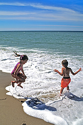 Boy & Girl Playing At Edge Of Water