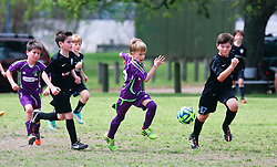 29 March 2015. New Orleans, Louisiana.<br /> U10 New Orleans Jesters Elites, Purple team play Mandeville. Jesters lose 3-4 to Mandeville who played a tough, physical game.<br /> Photo; Charlie Varley/varleypix.com