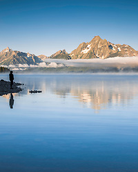 """Lady in landscape, Grand Teton National Park.  Low lingering clouds and Mt Moran cast their reflection in Jackson Lake.<br /> <br /> For production prints or stock photos click the Purchase Print/License Photo Button in upper Right; for Fine Art """"Custom Prints"""" contact Daryl - 208-709-3250 or dh@greater-yellowstone.com"""