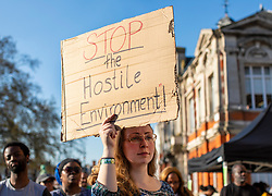 © Licensed to London News Pictures. 20/04/2018. London, UK. People gather to protest in Brixton's Windrush Square after it emerged that a number of Windrush generation migrants, who arrived in the UK from 1948-71, have been threatened with deportation by the Home Office.  Photo credit: Rob Pinney/LNP