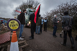 © Licensed to London News Pictures . 27/11/2013 . Manchester , UK . Protesters alongside lorries leaving the site . Energy firm IGas have today (Wednesday 27th November 2013) been receiving drilling equipment in readiness for exploratory drilling at the site . Anti fracking protesters have established a camp at Barton Moss in Greater Manchester alongside an access road leading to an IGas drilling site .  Photo credit : Joel Goodman/LNP