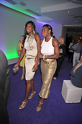 Left to right, Tennis players Venus Williams and Serena Williams at The Ralph Lauren Sony Ericsson WTA Tour Pre-Wimbledon Party hosted by Richard Branson at The Roof Gardens on June 18, 2009