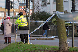© Licensed to London News Pictures.23/02/2021. London, UK. Police guard a crime scene afer fatal stabbing in Tottenham, north London. Police were called yesterday at 4pm to reports of a man believed aged in his 20s, stabbed in West Green Road. Despite the efforts of the emergency services the man was pronounced dead at the scene. Photo credit: Marcin Nowak/LNP