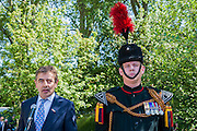 Rowan Atkinson on the No Man's Land:ABF The Soldier's Charity Garden. The Chelsea Flower Show 2014. The Royal Hospital, Chelsea, London, UK.