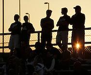 Minisink Valley football fans watch their team play Port Jervis as the sun sets in the background during a game in Slate Hill on Friday, Sept. 2, 2011.