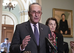 October 4, 2018 - Washington, District of Columbia, U.S. - United States Senate Minority Leader Chuck Schumer (Democrat of New York), left, makes a statement to reporters on the latest FBI report on Judge Brett Kavanaugh as United States Senator Dianne Feinstein (Democrat of California), right, ranking member, US Senate Committee on the Judiciary, looks on in the US Capitol in Washington, DC on Thursday, October 4, 2018. .Credit: Ron Sachs / CNP.(RESTRICTION: NO New York or New Jersey Newspapers or newspapers within a 75 mile radius of New York City) (Credit Image: © Ron Sachs/CNP via ZUMA Wire)