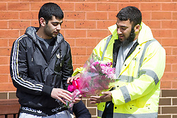 © Licensed to London News Pictures . 22/05/2013 . Bolton , UK . A single bunch of flowers is brought to the Zakaria Mosque , where the service takes place . Burial prayers for Baby Alia today (Wednesday 22nd May) whose body was discovered abandoned shortly before 4.55pm on Thursday March 14 in Ox Hey Lane , Lostock , near Bolton , by a man and woman out walking their dog . She was wrapped in clothes and a carrier back with a note requesting an Islamic burial . Police say the girl was born alive . They are yet to identify who her mother is . Photo credit : Joel Goodman/LNP