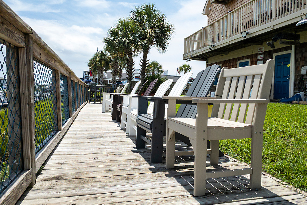 Comfortable seating on the ground level at Ocean Isle Fish Company in Ocean Isle Beach, North Carolina on Friday, August 6, 2021. Copyright 2021 Jason Barnette