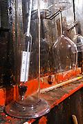 Chateau Pech-Latt. Near Ribaute. Les Corbieres. Languedoc. Wooden fermentation and storage tanks. Measuring cylinder. Alcohol densimeter hydrometer alcoholmeter. France. Europe. Bottle. Wine glass.