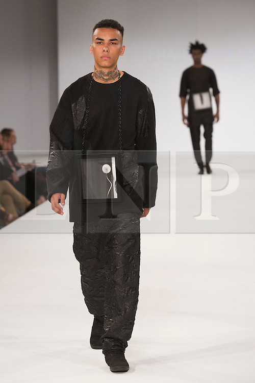 © Licensed to London News Pictures. 30/05/2015. London, UK. A model walks the runway during the UCA Rochester fashion show at Graduate Fashion Week 2015 wearing the collection of graduate student Francesca Espinosa-Baster. Graduate Fashion Week takes place from 30 May to 2 June 2015 at the Old Truman Brewery, Brick Lane. Photo credit : Bettina Strenske/LNP
