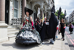 London, UK. 2 July, 2019. Climate change activists from Extinction Rebellion Art and Culture take part in a silent procession visiting the offices of five major oil companies - ENI, CNPC, Saudi Aramco, Repsol and BP - to declare them a crime scene.