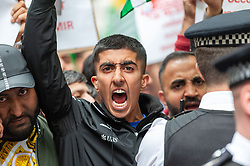 Demonstrators gathered outside India House in London to show support for Kashmiris and to protest against occupation and oppression by India in Kashmir.<br /> <br /> Police worked to keep the protesters and counter protesters apart through use of barriers, mounted police and lines of police. <br /> <br /> Richard Hancox | EEm 15082019
