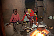 Noolkisaruni Tarakuai, the third of four wives of a Maasai chief, cooks  at her home in a Maasai village compound near Narok, Kenya.  (From the book What I Eat: Around the World in 80 Diets.)