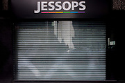 The metal shutters are down on the recently closed Jessops photo store in a side street of the City of London, the heart of the capital's financial district.  Jessops' store closures made over 1,350 staff redundant when they shut up shop at the start of the year with administrators PricewaterhouseCoopers admitting that at least some of the 192 stores would close. Other high-street chains such as HMV and the video chain, Blockbuster also closed at the beginning of 2013.