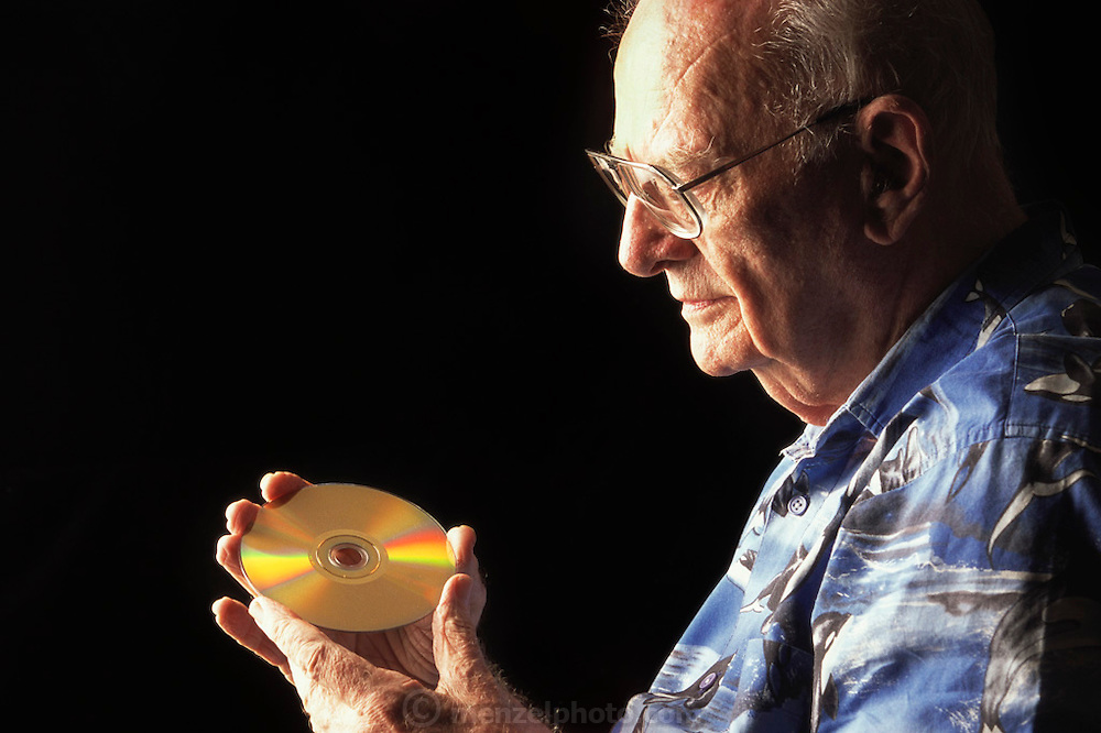 """Colombo, Sri Lanka.Sir Arthur C. Clarke holds a DVD copy of the movie 2001: A Space Odyssey. Clarke wrote, """"Any sufficiently advanced technology is indistinguishable from magic."""" Referring to the DVD in his hand, he said, """"If I were able to give Thomas Edison this disc, he would have no idea of what it was or how it worked. It would be magic."""" Sir Arthur is best known for the book 2001: A Space Odyssey. MODEL RELEASED"""