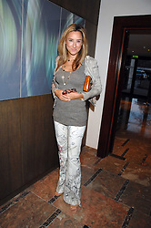 REBECCA KORNER at a party to celebrate the publication of Lisa B's book 'Lifestyle Essentials' held at the Cook Book Cafe, Intercontinental Hotel, Park Lane London on 10th April 2008.<br />
