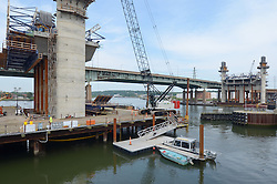 West and East Towers with River between, New Pearl Harbor Memorial Bridge under Construction at New Haven Harbor Crossing, Connectictut. CONNDOT Contract B, Project #92-618. When complete the alternately named Quinnipiac River Bridge will be first Extradosed Engineered & Designed Bridge in the United States.