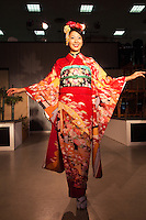 Kimono Show  Model at Nishijin Textiles...Kimono differ in style and color depending on the occasion on which it is worn and the age and marital status of the person wearing it. To put on a kimono needs some practice. Especially tying the belt (obi) alone is difficult so that many people require assistance. Wearing a kimono properly includes proper hair style, traditional shoes, socks, underwear, and a small handbag for women.