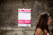 Romina Kajtazova - working as paralegal for NGO Kham - during door to door activity in Delcevo. They visit families, deliver brochures and putting up posters in the community to inform about health related issues and patients rights.