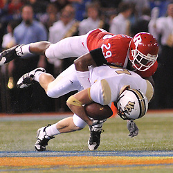 Dec 19, 2009; St. Petersburg, Fla., USA; Rutgers cornerback Zaire Kitchen (29) tackles UCF wide receiver Rocky Ross (5) during NCAA Football action in Rutgers' 45-24 victory over Central Florida in the St. Petersburg Bowl at Tropicana Field.