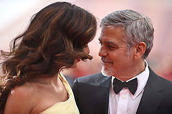 "File photo : George Clooney and his wife Amal Clooney attending the Money Monster screening at the Palais Des Festivals in Cannes, France on May 12, 2016, as part of the 69th Cannes Film Festival. Amal Clooney and her husband George are expecting twins, US media report. The babies are due in June, according to CBS's The Talk host Julie Chen. Another source close to the couple, quoted by People, said they were ""very happy"". The Clooneys' representatives have not yet commented. Photo by Lionel Hahn/ABACAPRESS.COM"