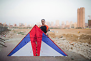 A Chinese man poses with his kite in a construction site in Datong, China, July 24, 2014.<br /> <br /> Food and games are a real pleasure for the life of Chinese community. <br /> At home, in the streets, at the park or in restaurants, the chance to find someone eating or playing is considerably high.<br /> <br /> © Giorgio Perottino