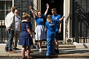 Matthew Tovey and other NHS workers from the grassroots NHSPay15 campaign, supported by former Labour Party leader Jeremy Corbyn, celebrate outside 10 Downing Street after presenting a petition signed by over 800,000 people calling for a 15% pay rise for NHS workers on 20th July 2021 in London, United Kingdom. At the time of presentation of the petition, the government was believed to be preparing to offer NHS workers a 3% pay rise in recognition of the unique impact of the pandemic on the NHS.