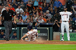 May 23, 2018 - Houston, TX, U.S. - HOUSTON, TX - MAY 23: Houston Astros second baseman Jose Altuve (27) touches home-plate scoring on Houston Astros shortstop Carlos Correa (1) single in the fifth inning during MLB baseball game between the Houston Astros and the San Francisco Giants on May 23, 2018 at Minute Maid Park in Houston, Texas. (Photo by Juan DeLeon/Icon Sportswire) (Credit Image: © Juan Deleon/Icon SMI via ZUMA Press)