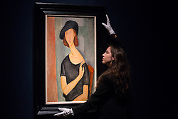 © licensed to London News Pictures. London, UK 01/02/2013. 'Jeanne Hebuterne' by Amedo Modigliani expected to be sold for £16-22 million in Christie's  Impressionist and Modern Art sale which will take place in London on 6th February 2013, total pre-sale estimate of the auction is £98.3 million to £146.58 million. Photo credit: Tolga Akmen/LNP