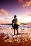 Portrait of a cast net maker at sunrise on the Atlantic Ocean in Jacksonville, Florida.  Photographed for Coastal Living Magazine.