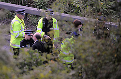 © Licensed to London News Pictures. 06/09/2013<br /> Police next to the M25 before the tolls.<br /> Dartford Bridge and Tolls closed in both direct due to a security alert. One man arrested and a suspicious item found on M25. M25 CLOSED IN BOTH DIRECTIONS.  Police holding traffic on the bridge towards Kent.<br /> Photo credit :Grant Falvey/LNP