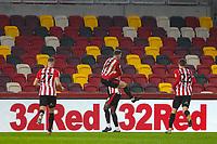 Football - 2020 / 2021 Sky Bet (EFL) Championship - Brentford vs. Wycombe Wanderers  - Brentford Community Stadium<br /> <br /> Sergi Canos (Brentford  FC) leaps onto Josh Dasilva (Brentford  FC) after he scores his teams 5th goal<br /> <br /> COLORSPORT/DANIEL BEARHAM