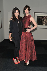 Left to right, DAISY LOWE and ERIN O'CONNOR at the IWC Schaffhausen Gala Dinner in honour of the British Film Institute held at the Battersea Evolution, Battersea Park, London on 7th October 2014.