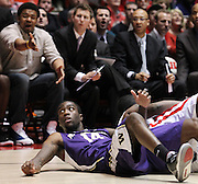 Washington's Tony Wroten (14) and the Washington bench react to the Huskies guard getting called for a foul after going after a loose ball against Utah during the second half of an NCAA college basketball game in Salt Lake City, Saturday, Jan. 7, 2012. Washington defeated Utah 57-53. (AP Photo/Colin E Braley)