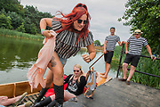 Safely back on dry land after punting on the lake - The 2017 Latitude Festival, Henham Park. Suffolk 15 July 2017